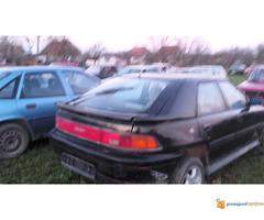 Mazda 323 F delovi